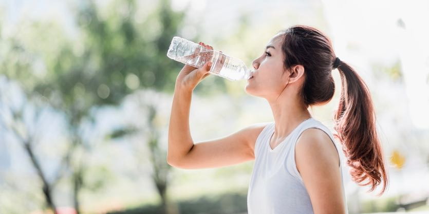 Asian-female-drinking-water